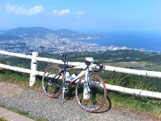 Tesseract's bike and view of Otaru from the Observatory
